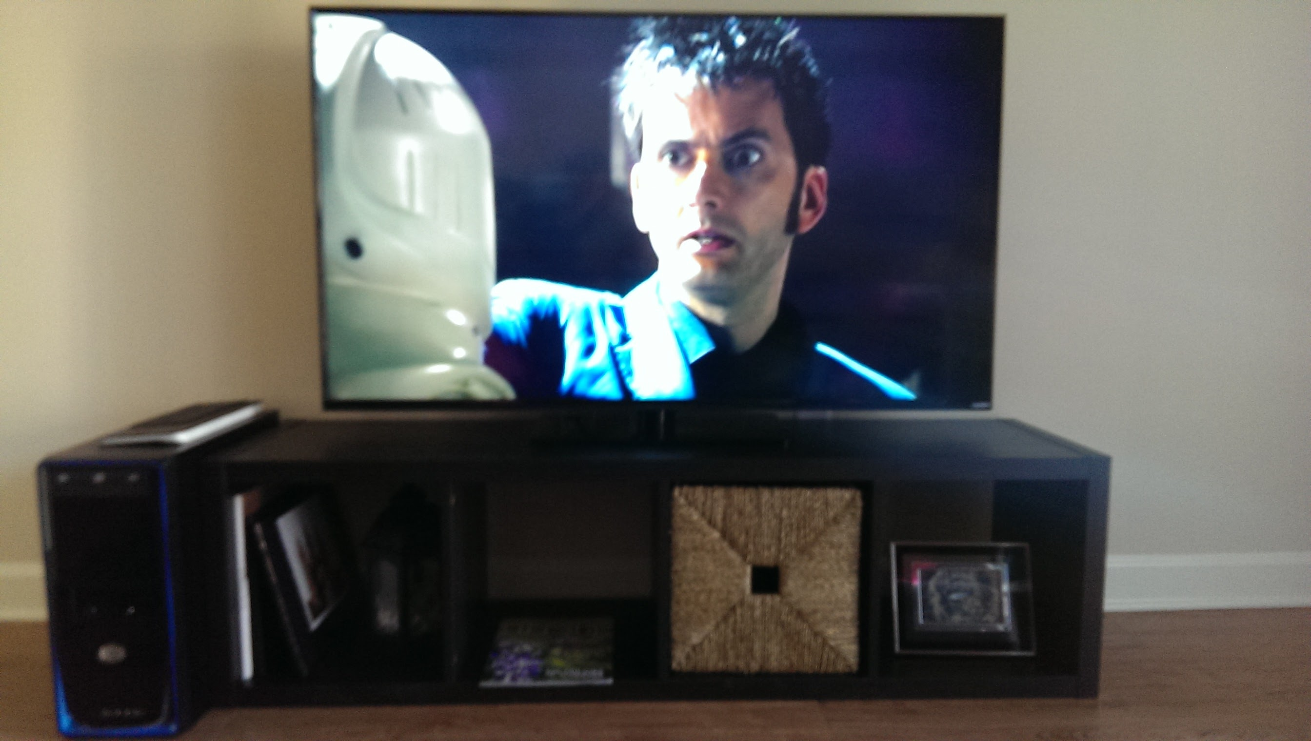 Entertainment center with a TV showing Doctor Who
